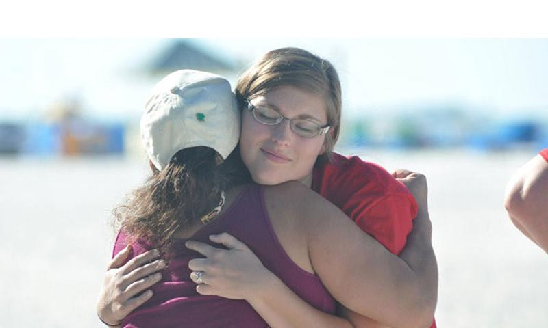 Two women hug at a remembrance ceremony at the National Military Suicide Survivor Seminar earlier this month in St. Petersburg, Fla. The program brings together survivors of service member loved ones who committed suicide. Heath Druzin/Stars and Stripes (Heath Druzin/Stars and Stripes)