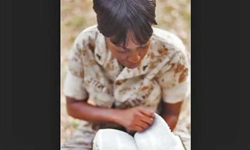 A video screen grab shows former Lance Cpl. Monifa Sterling reading a Bible. The Marine was court-martialed for not removing a Bible verse from her desk computer. (YouTube)