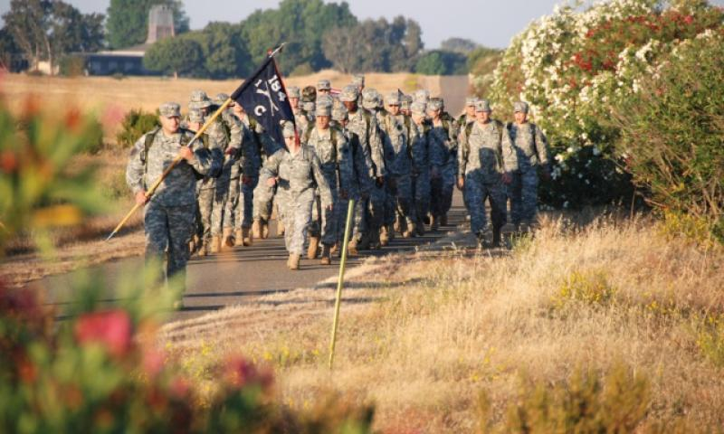 Led by the 184th Infantry Company guidon, more than 40 California National Guard soldiers march on Aug. 24, 2007, in Rancho Cordova, Calif., to honor the nine soldiers killed while the company was deployed to Iraq in 2005-2006. (U.S. Army)