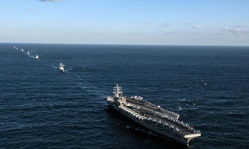 The Ronald Reagan Carrier Strike Group and South Korean navy ships steam in formation during an exercise Tuesday, Oct. 27, 2015, in international waters to the east of the Korean Peninsula. Two Russian aircraft flew within one nautical mile at a height of 500 feet, prompting the carrier to launch four fighter jets in response. The Russian aircraft left without further incident. (Nathan Burke/U.S. Navy)