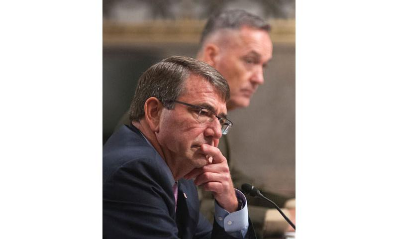 Secretary of Defense Ash Carter listens to comments during a Senate Committee on Armed Services hearing on Capitol Hill in Washington, D.C., on Tuesday, Oct. 27, 2015. During the hearing, Carter said raids like the one in Iraq involving U.S. troops likely will be a part of the U.S. strategy in the region. (Carlos Bongioanni/Stars and Stripes)