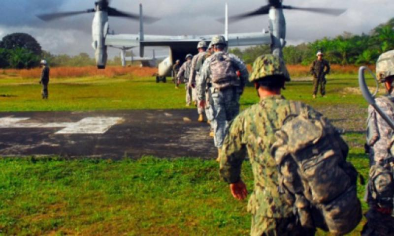 Military personnel supporting Operation United Assistance enter a U.S. Marine Corps MV-22 Osprey to depart Cesco City, Liberia. U.S. Africa Command is supporting the effort by providing command and control, logistics, training and engineering assets to contain the Ebola virus outbreak in West African nations. (Craig Philbrick/U.S. Army)