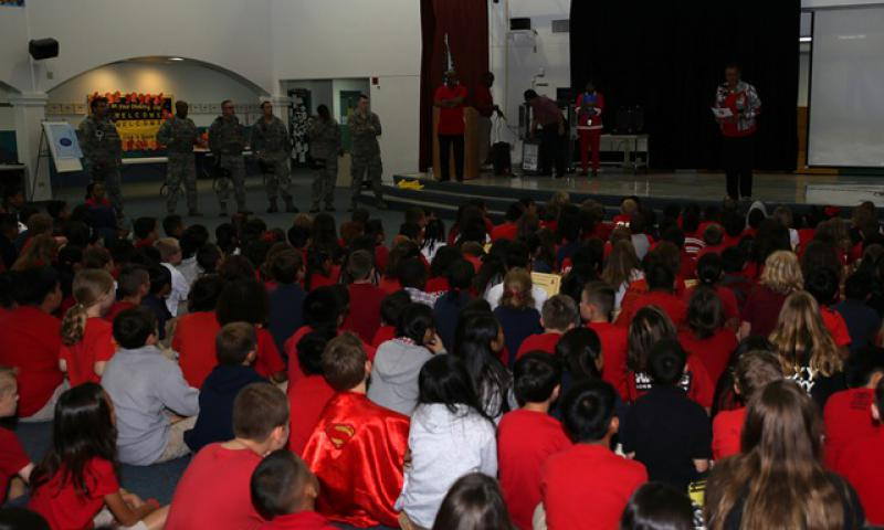 Willette Horne-Barnes, Andersen Elementary School principal, reads the National Red Ribbon Week Campaign proclamation to students Oct. 29, 2014, on Andersen Air Force Base, Guam. More than 800 students gathered in an assembly to learn about Red Ribbon Week and the importance of drug-free lifestyles. (U.S. Air Force photo by Staff Sgt. Melissa B. White/Released)