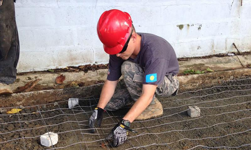An Airman from the 36th Civil Engineer Squadron repairs a roadway during a Civil Action Team deployment to Palau in September. Multi-service units from multiple bases are improving Palauan's lives by fixing the infrastructure, updating medical practices and implementing running water. (U.S Air Force courtesy photo)