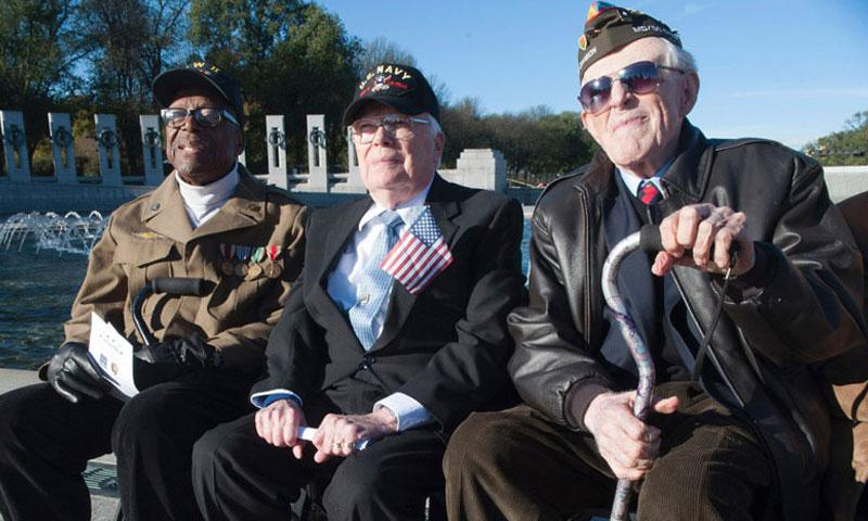 World War II veterans await the start of Veterans Day ceremonies at the National World War II Memorial in Washington, D.C., in November, 2015. (Stars and Stripes)