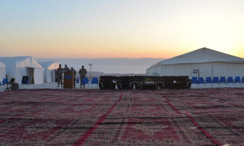 A floor of carpets is seen in the foreground as the sun sets at a Jordanian camp where U.S. servicemembers were training on May 16, 2015. The Pentagon said Friday Nov. 4, 2016, that three Americans were killed and in a shooting incident at al-Jafr base, Jordan, on Nov. 4, 2016. (Stars and Stripes)