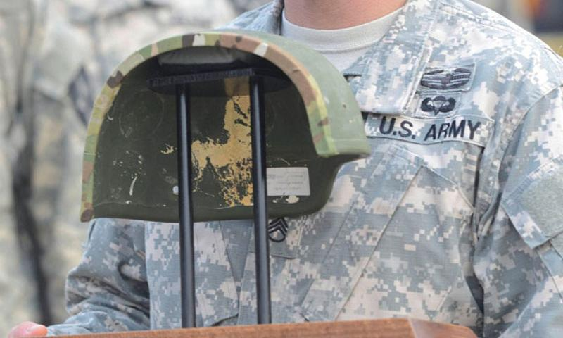 Staff Sgt. Ryan Frye displays the helmet that saved his life when he was struck during a 2012 attack in Afghanistan. Frye, now stationed in South Korea, was given back the helmet after it was inspected by Army researchers.