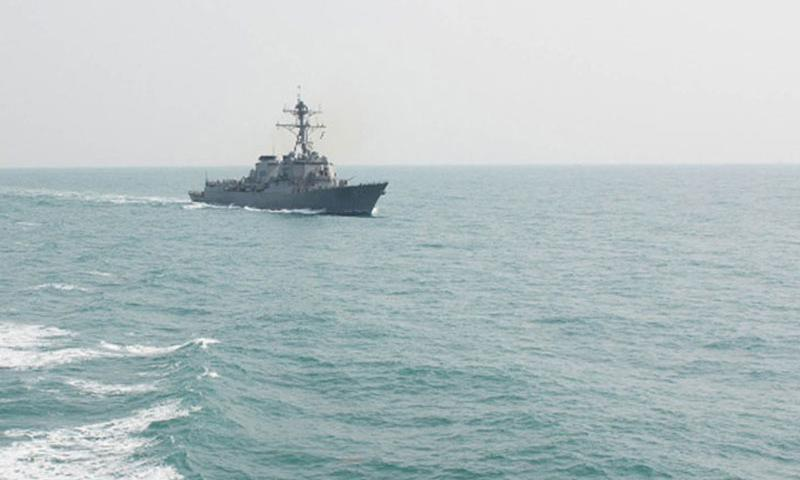 The guided-missile destroyer USS Lassen conducts surfarce warfare operations in the East China Sea in February. Last week, the ship made headlines around the globe when it challenged claims by China over man-made islands in the South China Sea. (Lauren Chatmas/U.S. Navy)