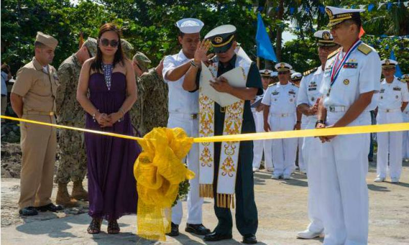 Rear Adm. Caesar Taccad, vice commander of the Philippine Navy, far right, observes the benediction of a newly completed U.S. Navy Seabee boat ramp construction project at Philippine Headquarters Naval Special Operations Group, Naval Base Heracleo Alano. Sailors from U.S. Navy Underwater Construction Team Two (left), stationed at Point Hueneme, Calif., helped with the construction effort. (U.S. Navy photo by Mass Communication Specialist 2nd Class (EXW) Timothy Wilson/Released)