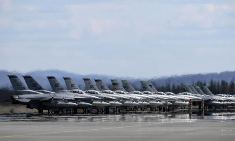 Air Force F-16 Fighting Falcons assigned to 121st Fighter Squadron, Joint Base Andrews, Md., and 112th Fighter Squadron, Toledo Air National Guard Base, Ohio, stand by for launch during drills last year at Eielson Air Force Base, Alaska. (Peter Reft/U.S. Air Force)