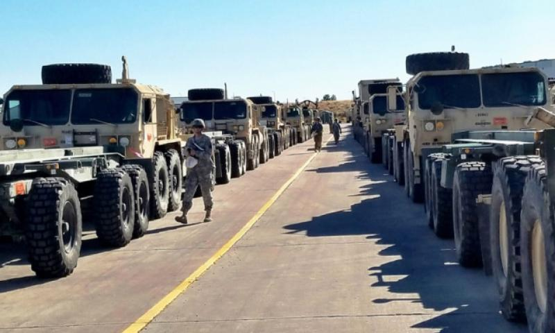 Soldiers from Fort Carson, Colo., stage tactical vehicles for loading on to trains on Nov. 7, 2016, as the vehicles are prepped to be transported to Bremerhaven, Germany. (Ange Desinor/U.S. Army)