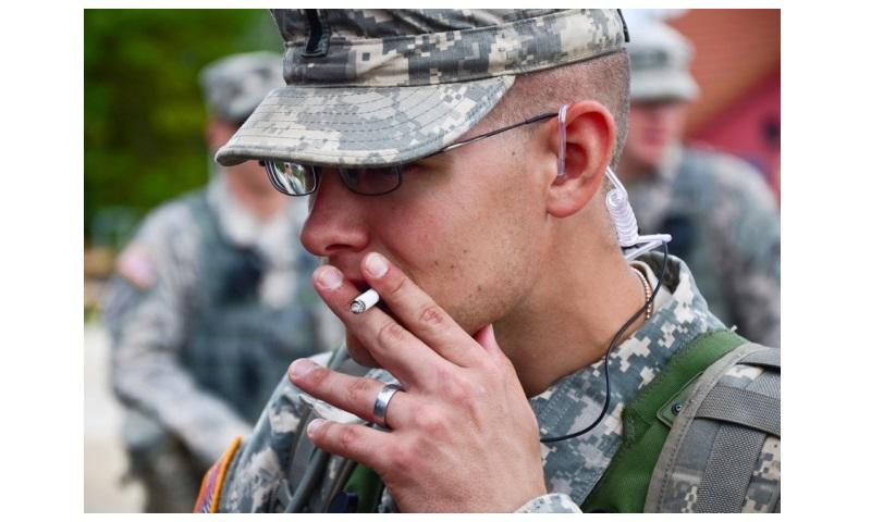 A U.S. soldier smokes a cigarette during a Kosovo Forces training exercise at the Joint Multinational Readiness Center in Hohenfels, Germany, Aug. 25, 2012. (U.S. Army)