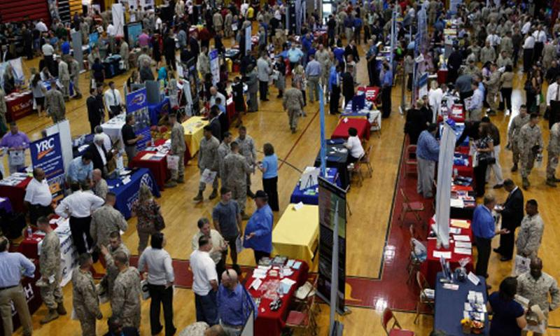 More than 140 employers and education representatives mingle with more than 1,000 base and reserve personnel, their families, veterans and students during a job fair at Camp Lejeune, N.C., on Sept. 25, 2013. (Charles Clark/U.S. Marines)