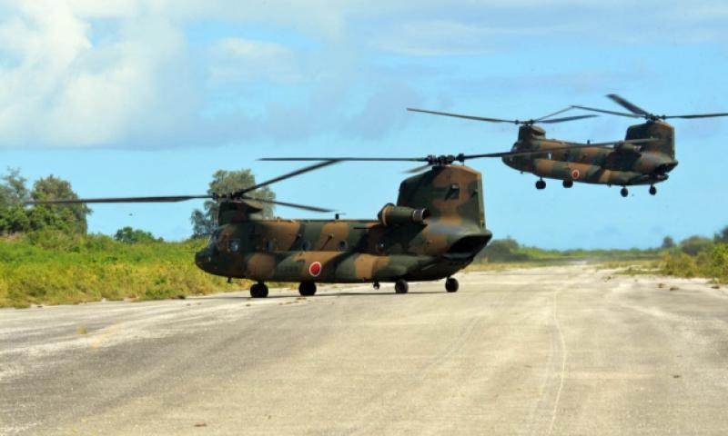 Japan Self-Defense Forces helicopters land on a World War II-era runway on Tinian, in the Northern Marianas, Tuesday, Nov. 8, 2016. U.S. forces assisted the Japanese-led event as part of the bilateral Keen Sword exercise. (Erik Slavin/Stars and Stripes)