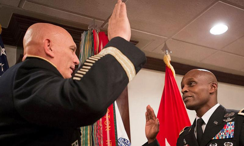 Chief of Army Public Affairs then Maj. Gen. Ronald F. Lewis reaffirms his oath just after being promoted during a ceremony hosted by Army Chief of Staff Gen. Raymond T. Odierno at the Pentagon in Arlington, Va., on Jan. 7, 2014. Lewis, now a lieutenant general, was relieved from his post as a top assistant to Secretary of Defense Ash Carter on Thursday, Nov. 12, 2015. (Bernardo Fuller/U.S. Army)