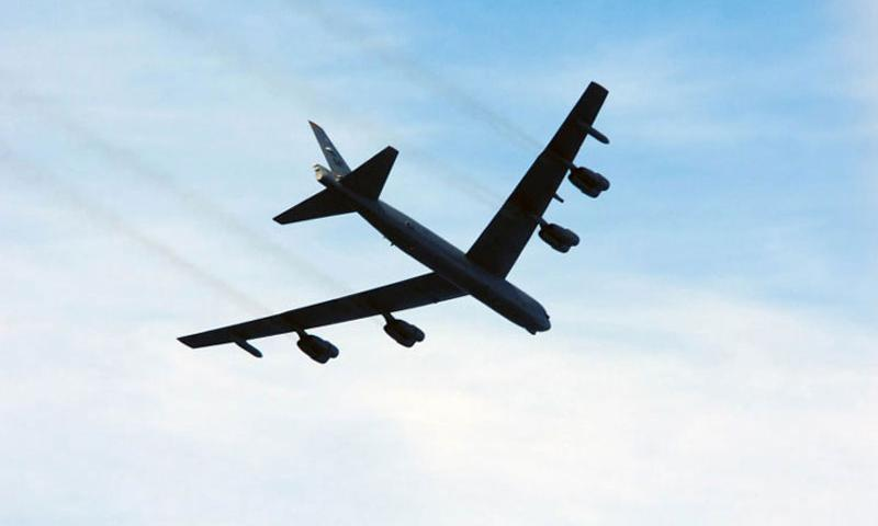 A U.S. Air Force B-52 Stratofortress flies above the aircraft carrier USS Ronald Reagan in 2010. Two Air Force B-52 bombers flew over international airspace within 15 nautical miles of one of the Spratly Islands recently, prompting a Chinese radio warning. (Joseph Buliavac/U.S. Navy photo)