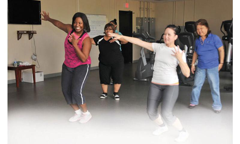 Move Your Body: Naval Facilities Engineering Command (NAVFAC) Marianas, Acting Deputy Operations Officer and Integrated Product Team Project Manager Raquan Hall, left, leads her co-workers during a Zumba session at the gym at the NAVFAC Marianas headquarters in Asan Oct. 12. Photo by JoAnna Delfin, courtesy of U.S. Navy