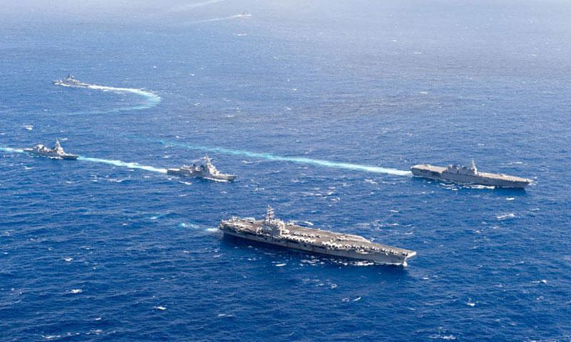 The aircraft carrier USS Ronald Reagan and Japan Maritime Self-Defense Force helicopter destroyer JS Izumo lead ships breaking formation during Keen Sword drills in the Philippine Sea, Friday, Nov. 11, 2016. President-elect Donald Trump has pledged to boost the Navy fleet to 350 ships. (U.S. Navy photo)