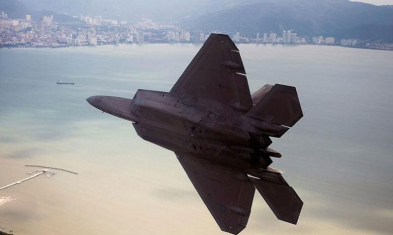 An Air Force F-22 Raptor from Joint Base Pearl Harbor-Hickam, Hawaii, prepares to land at Royal Malaysian air force P.U. Butterworth, Malaysia, on June 16, 2014. The Pacific Air Force command will not have to cut any personnel due to budget cuts, officials announced Nov. 17, 2014. (Jason Robertson/U.S. Air Force)
