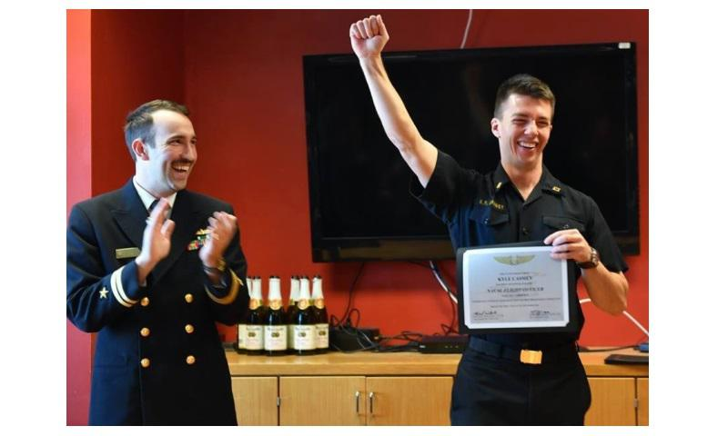 A U.S. Naval Academy midshipman celebrates his assignment. (U.S. Naval Academy)