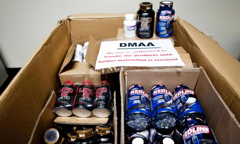 Bottles of dietary supplements containing dimethylamylamine, or DMAA, sit in boxes in the Yokota, Japan, exchange store room in 2012 after the Army and Air Force Exchange Service pulled the supplements from the shelves while the Defense Department investigated a possible link between DMAA and the deaths of two soldiers. (Grant Okubo/Stars and Stripes)