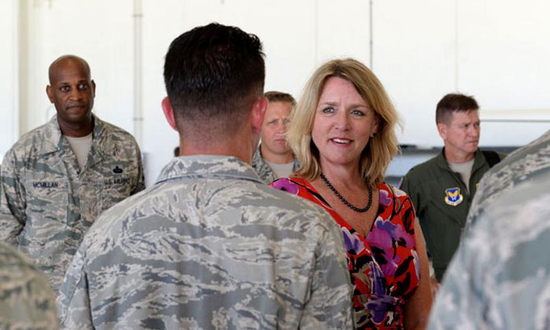 Secretary of the Air Force Deborah Lee James learns about RQ-4A Global Hawk mission capabilities from talking with 69th Reconnaissance Squadron, Detachment 2 Airmen Nov. 19, 2014, at Andersen Air Force Base, Guam. The Secretary met and discussed Air Force policies and goals with Airmen and local community leaders during her two-day visit to Andersen and received a first-hand look at the base's critical role in the strategic Pacific rebalance. (U.S. Air Force photo by Airman 1st Class Amanda Morris/Released)
