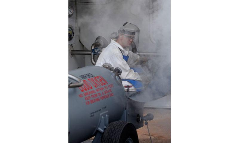 Senior Airman Charles Medley, 36th Logistics Readiness Squadron cryogenics production supervisor, prepares to distribute liquid oxygen Nov. 7, 2017, at Andersen Air Force Base, Guam. The cryogenics production flight generates, stores and distributes pure, breathable liquid oxygen and clean nitrogen. (U.S. Air Force photo/ Airman 1st Class Gerald R. Willis)