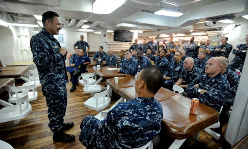 U.S. Pacific Fleet Master Chief Marco Ramirez speaks to first class petty officers and chief petty officers during 365 training aboard the guided-missile destroyer USS Paul Hamilton (DDG 60). During the training, Ramirez spoke about senior enlisted leadership, operating in the Pacific theater, integrity and responsible drinking. (U.S. Navy photo by Senior Chief Mass Communication Specialist Michael Lewis/Released)