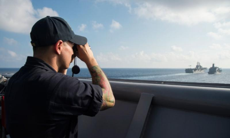 Ensign Louis Melgar uses a range finder aboard the USS Germantown on Oct. 24, 2016 in the South China Sea. (Raymond D. Diaz III/U.S. Navy)