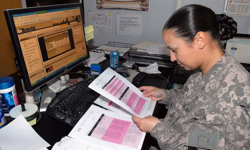 In a 2009 file photo, a soldier with 1st Cav. Div., Multi-National Division-Baghdad, works on a statistics lesson in the Masters in Business Administration program at the University of Phoenix online during her lunch hour. (U.S. Army)