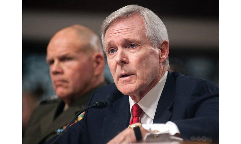 Navy Secretary Ray Mabus answers questions during a Senate Armed Services Committee hearing on Capitol Hill in Washington on Feb. 2, 2016. Looking on is Marine Corps Commandant Gen. Robert Neller. (Carlos Bongioanni/Stars and Stripes)