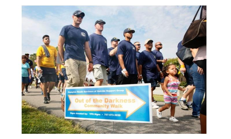 Sailors and family members from the USS Abraham Lincoln participate in an Out of the Darkness Walk to raise suicide awareness in Virginia Beach, Va., Sept. 10, 2016. (Josue L. Escobosa/U.S. Navy)