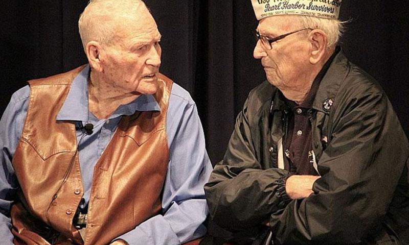 "Pearl Harbor veterans James Leavelle, left, and Adone ""Cal"" Calderone, at the 19th annual American Veterans Center Veterans Conference & Honors and National Youth Leadership Summit in Washington, D.C., in November, 2016. Leavelle was the first person to interrogate Lee Harvey Oswald after the assassination of President John F. Kennedy. (Ken-Yon Hardy/Stars and Stripes)"