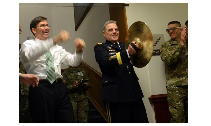 Chief of Staff of Army Gen. Mark A. Milley, right, plays cymbals during an Army pep rally while Secretary of the Army Dr. Mark T. Esper, left, cheers on the crowd. (Photo Credit: U.S. Army photo by David Vergun)
