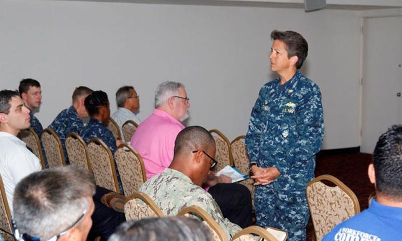 Capt. Stephanie Jones, NAVFAC Marianas commanding officer, speaks to more than 100 contractor partners during a safety stand down Dec. 9 at the Top of the Mar on Nimitz Hill.  Jones praised the team's safety record and challenged the team to maintain a robust safety program through personal accountability. (U.S. Navy Photo/Released)