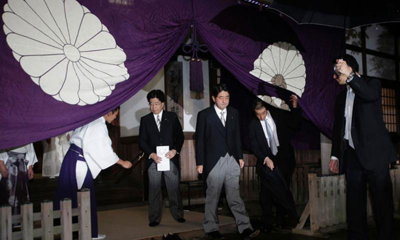 "Shinzo Abe, then a candidate for Japan's prime minister position, is seen leaving the Yasukuni Shrine after he paid homage to the war dead in Tokyo on Oct. 17, 2012. Moves such as the visit, and Japan's refusal to apologize for the use of Korean ""comfort women"" during World War II has kept South Korea-Japan relations from moving forward, analysts say. (The Associated Press)"