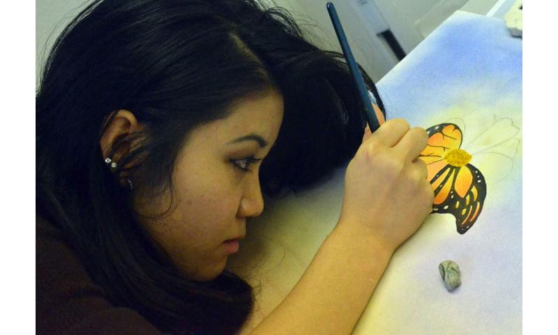 Humphreys High senior Reimi Edson puts some touches on a paint design of a butterfly Dec. 14, 2015, at the DODD's Far East Film and Creative Expressions festival in Tokyo. Dave Ornauer/Stars and Stripes (Dave Ornauer/Stars and Stripes)