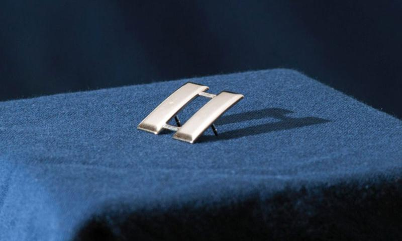 The rank of captain has been symbolized by double silver bars since 1832, and is sometimes referred to as railroad tracks. (Robert Barnett/U.S. Air Force)