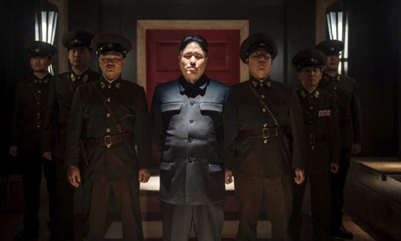 "Actor Randall Park, center, portrays North Korean leader Kim Jong Un in Columbia Pictures' ""The Interview."" (Ed Araquel/Columbia Pictures, Sony)"