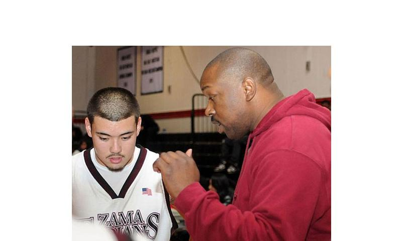 Zama American High coach Parish Jones makes a point to junior guard Andre Encarnacion during a DODDS Japan/Kanto Plain Association of Secondary Schools basketball game at Zama American, Japan, in this undated file photo. (Dave Ornauer/Stars and Stripes)