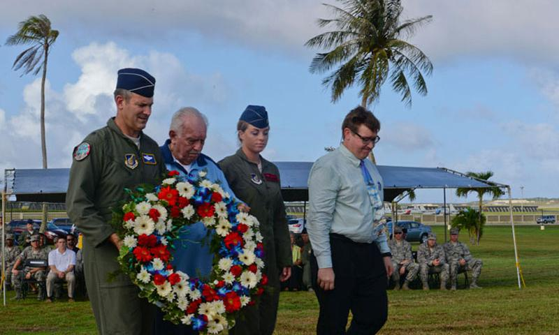 Brig. Gen. Andrew Toth, 36th Wing commander and Lt. Col. (ret.) Chuck McManus along with other Team Andersen members lays the ceremonial wreath during the Operation Linebacker II Remembrance Ceremony Dec. 18, 2014, at Andersen Air Force Base, Guam. McManus was a B-52 pilot stationed at Andersen during the operation. (U.S. Air Force photo by Staff Sgt. Robert Hicks/Released)