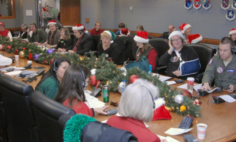 "Volunteers at Peterson Air Force Base, Colo., are gearing up to answer phone calls and emails from children around the world checking on Santa's whereabouts during the North American Aerospace Defense Command's ""NORAD Tracks Santa"" event Dec. 24. In this photo, taken Dec. 24, 2011, in the NORAD Tracks Center operations center, more than 1,200 volunteers keep the tradition that started in 1955 alive. U.S. Air Force photo by Tech. Sgt. Thomas J. Doscher"