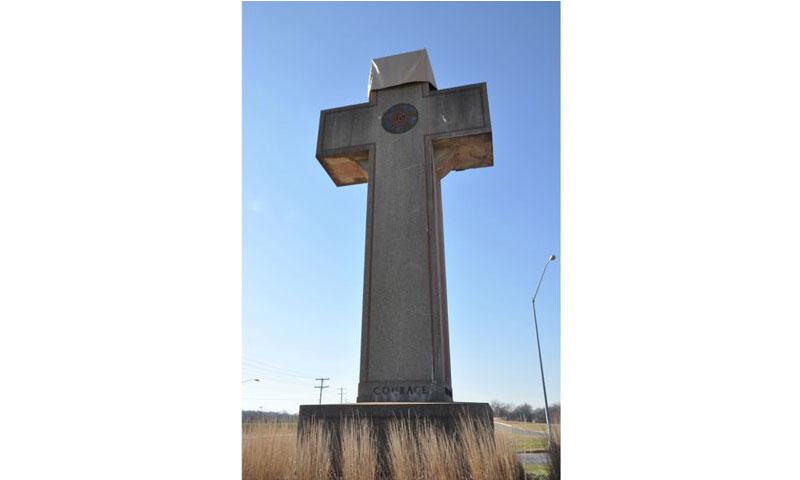 The Peace Cross in Bladensburg, Md., a memorial to soldiers killed in World War I, is at the heart of a lawsuit that claims the 40-foot cross on government property violates the First Amendment. The cross has a cover to protect it from rain damage. (Dianna Cahn/Stars and Stripes)