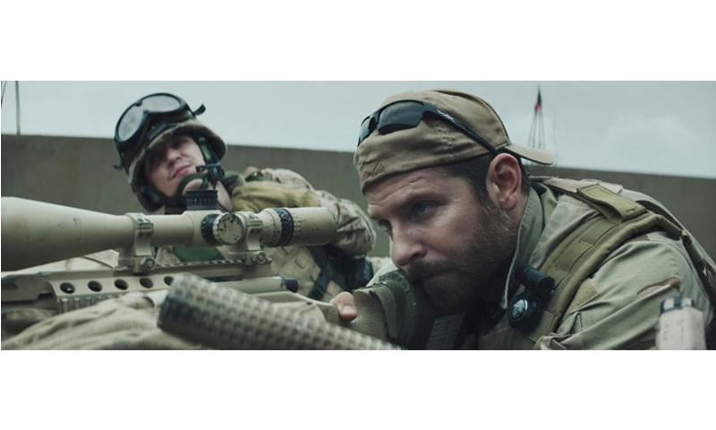 "Kyle Gallner, left, as Goat-Winston and Bradley Cooper as Chris Kyle star in Warner Bros. Pictures' and Village Roadshow Pictures' drama ""American Sniper."" (Warner Bros. Pictures/Tribune News Service)"