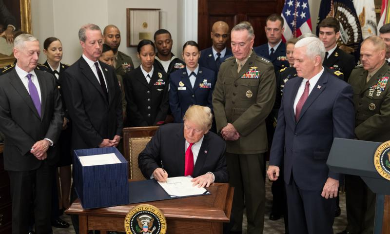 WASHINGTON (Dec. 12, 2017) President Donald J. Trump, joined by Vice President Mike Pence and senior military leaders, signs H.R. 2810, the National Defense Authorization Act for fiscal year 2018, in the Roosevelt Room at the White House, Dec. 12, 2017. (White House photo by Stephanie Chasez/Released)