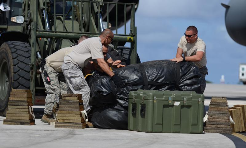 Airmen from the 36th Contingency Response Group rearrange equipment on a forklift Nov. 15, 2013, on the Andersen Air Force Base, Guam, flightline before departing to support Operation Damayan in Tacloban City, Philippines. Operation Damayan is a U.S. humanitarian aid and disaster relief effort to support the Philippines in the wake of the devastating effects of Typhoon Haiyan. (U.S. Air Force photo by Senior Airman Marianique Santos)