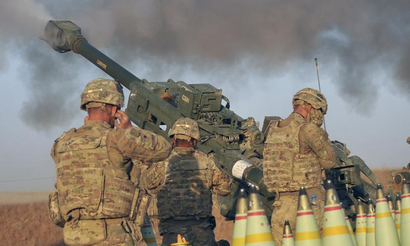 In an Aug. 14, 2016 file photo, U.S Army Soldiers with Battery C, 1st Battalion, 320th Field Artillery Regiment, Task Force Strike, execute a fire mission in northern Iraq during an operation to support the Iraqi army. Daniel I Johnson/U.S. Army