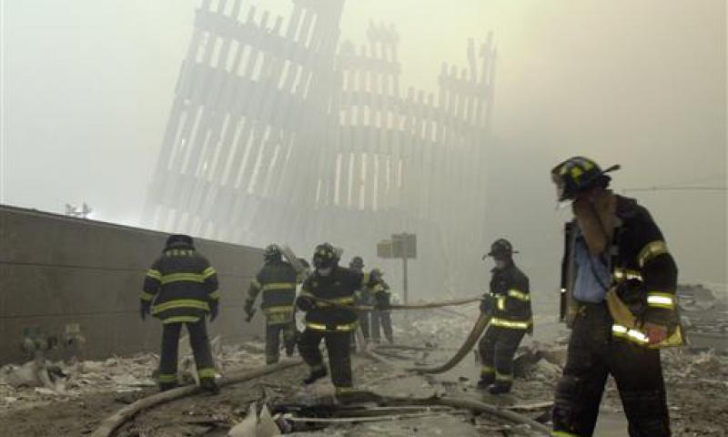 In this Sept. 11, 2001, file photo, firefighters work beneath the destroyed mullions, the vertical struts which once faced the soaring outer walls of the World Trade Center towers, after a terrorist attack on the twin towers in New York. White House and intelligence officials are deciding whether to declassify 28 pages of a congressional investigation into the Sept. 11 attacks. The still-secret chapter could answer or raise new questions about possible Saudi links to the attackers. 	 Mark Lennihan/AP