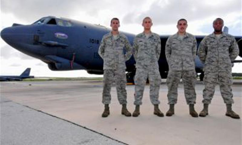 """Nine-O-Nine"" award winners Staff Sgt. Nicholas Tullis, Airman 1st Class Bruce Brimm, Senior Airman Cody Farley and Staff Sgt. Oliver Johnson, 36th Expeditionary Aircraft Maintenance Squadron crew chiefs, stand in front of B-52 Stratofortress A1018 on the flightline at Andersen Air Force Base. (U.S. Air Force photo/Senior Airman Benjamin Wiseman)"
