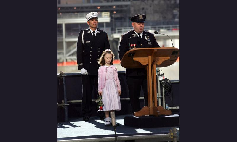 Patricia Smith stands by her father NYC policeman James Smith, as they commemorate the loss of her mother, Moira Smith, also a NYC police officer during the September 11th Commemoration Ceremony at Ground Zero of the World Trade Center in Manhattan, New York, Monday, September 11, 2006.   Bruce Gilbert, Newsday/MCT
